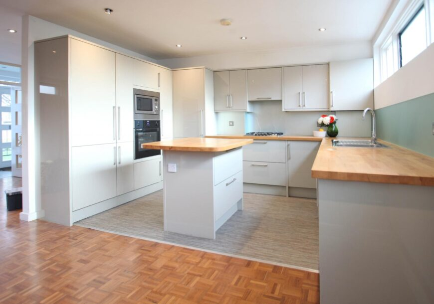 HOWDENS Modern Gloss Used Kitchen with Island, Wooden Worktops, London